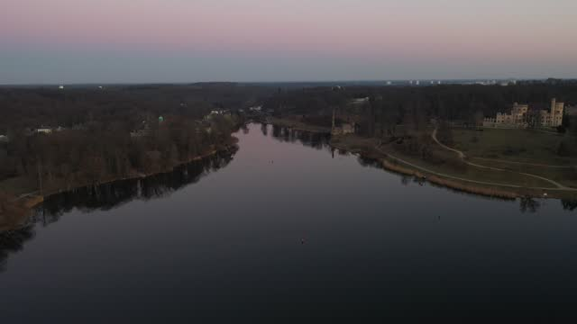 in this aerial view from a drone the babelsberg palace stands next to glienicke bridge and havel river at sunset during the novel coronavirus... - palace stock videos & royalty-free footage