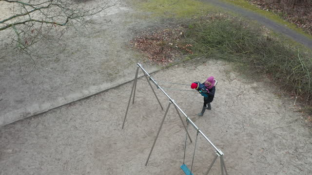 in this aerial view from a drone, the photographer's son swings on a playground during the second wave of the coronavirus pandemic on february 28,... - number 4 stock videos & royalty-free footage