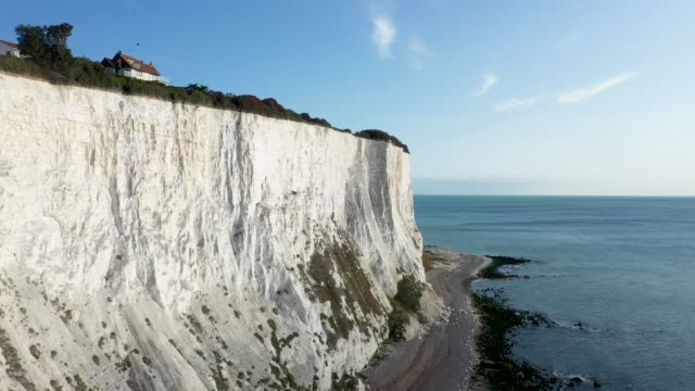 in this aerial view from a drone, the shingle beaches and rocky cliff bottoms of the st margaret's bay and the white cliffs of dover continue to be... - cliff stock videos & royalty-free footage