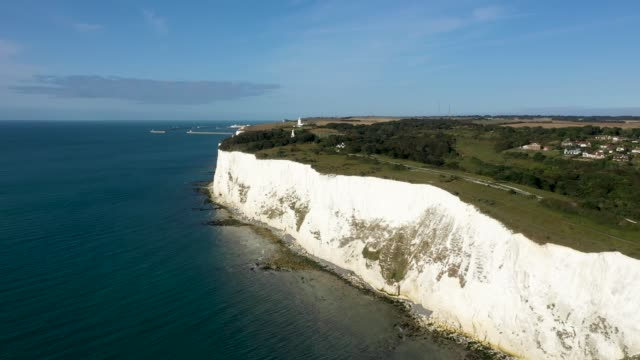 in this aerial view from a drone, the shingle beaches and rocky cliff bottoms of the st margaret's bay and the white cliffs of dover continue to be... - bay of water stock videos & royalty-free footage