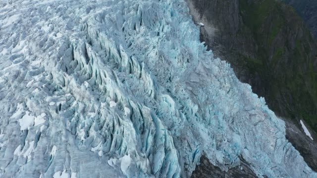 in this aerial view from a drone the supphellebreen glacier descends towards the supphelledalen valley on august 12, 2020 near fjaerland, norway. the... - waterfall stock videos & royalty-free footage