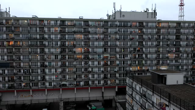 stockvideo's en b-roll-footage met in this aerial view from a drone, the windows of residential apartment buildings are illuminated in the evening in schoeneberg district during the... - non urban scene