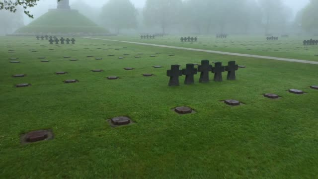 in this aerial view graves lie in morning fog at the la cambe german war cemetery on april 29, 2019 near la cambe, france. the cemetery contains the... - cemetery stock videos & royalty-free footage
