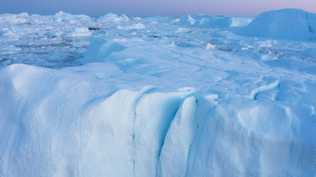 in this aerial view icebergs and ice float jammed into the ilulissat icefjord on august 04 2019 near ilulissat greenland the sahara heat wave that... - greenland stock videos & royalty-free footage