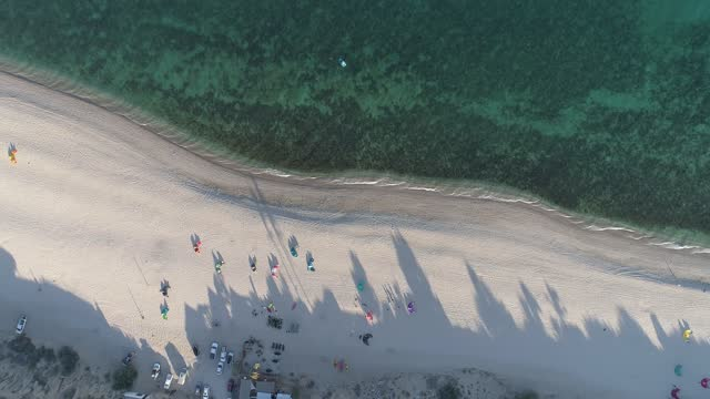 in this aerial view, kitesurfing kites are seen on the beach at the end of the day during covid-19 pandemic at playa la ventana on january 16, 2021... - northern mexico stock videos & royalty-free footage