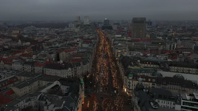 in this aerial view lights hang on trees during the christmas shopping season on kurfuerstendamm avenue, berlin's most famous shopping street during... - カイザー・ヴィルヘルム記念教会点の映像素材/bロール