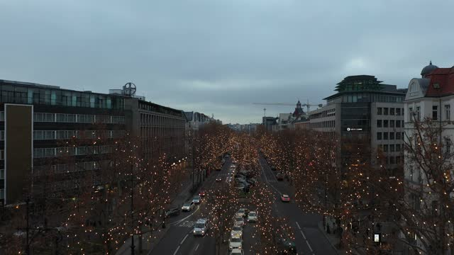in this aerial view lights hang on trees during the christmas shopping season on kurfuerstendamm avenue, berlin's most famous shopping street during... - regeln stock-videos und b-roll-filmmaterial
