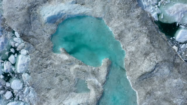 in this aerial view melting ice forms a lake on freefloating ice jammed into the ilulissat icefjord during unseasonably warm weather on july 30 2019... - lake stock videos & royalty-free footage