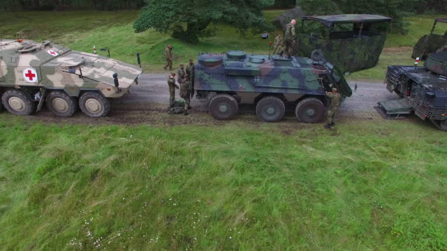 in this aerial view members of the bundeswehr, the german armed forces, walk among puma infantry fighting vehicles and other aromour following a... - infantry stock videos & royalty-free footage