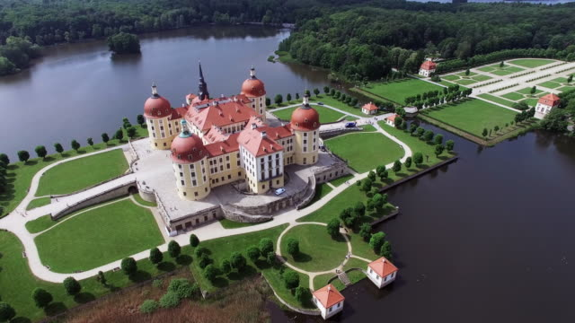in this aerial view moritzburg castle stands on may 26, 2016 in moritzburg, germany. moritzburg castle is a baroque palace that was originally built... - saxony stock videos & royalty-free footage