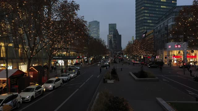 in this aerial view people walk past tauentzienstrasse in the district charlottenburg, which is decorated with christmas lights, during the... - カイザー・ヴィルヘルム記念教会点の映像素材/bロール