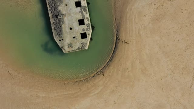vídeos de stock, filmes e b-roll de in this aerial view pontoons from the world war ii allied temporary mulberry harbor built during the dday invasion lie on the beach on april 30 2019... - arromanches