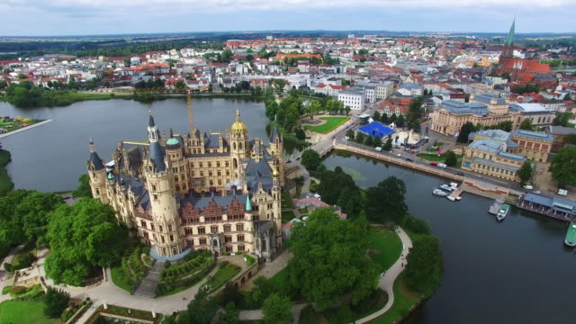 in this aerial view schloss schwerin castle seat of the state parliament of the state of mecklenburgwestern pomerania and also a unesco wolrd... - unesco stock videos & royalty-free footage