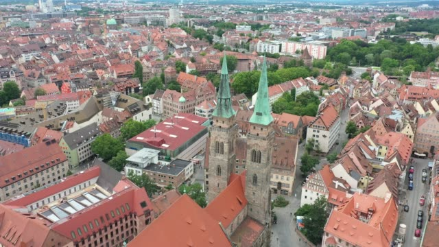in this aerial view st. sebald - sebaldus church , one of the the oldest of the city, stands during the novel coronavirus pandemic on july 05, 2020... - panorama stock-videos und b-roll-filmmaterial
