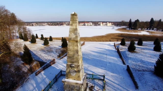 In this aerial view the Rheinsberg Obelisk which commemorates Prussian sacrifices in the Seven Years' War stands as Schloss Rheinsberg palace and...