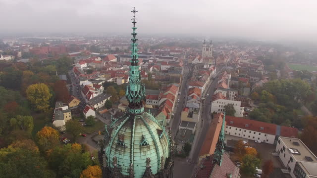 in this aerial view the schlosskirche church on whose doors theologian martin luther nailed his 95 theses in 1517 stands as the stadtkirche sankt... - martin luther religious leader stock videos & royalty-free footage