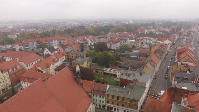 in this aerial view the stadtkirche sankt marien church where theologian martin luther preached and held the first vernacular mass stands in the... - martin luther religious leader stock videos & royalty-free footage