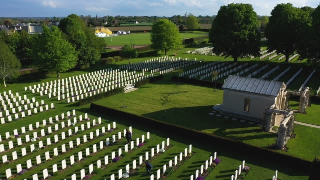 in this aerial view the sun sets over graves at the commonwealth war graves commission's bayeux war cemetery on may 3, 2019 at bayeux, france. the... - d day stock videos & royalty-free footage