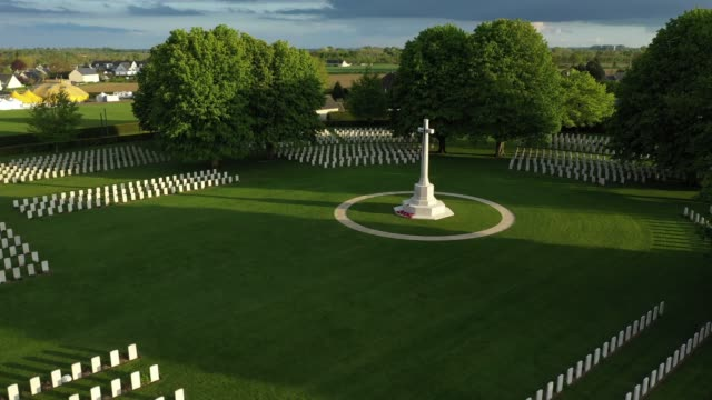 in this aerial view the sun sets over graves at the commonwealth war graves commission's bayeux war cemetery on may 3 2019 at bayeux france the... - d day stock-videos und b-roll-filmmaterial