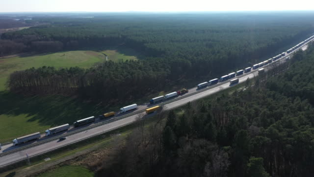 in this aerial view trucks on the a12 highway stand backed up approximately 70km before germany's border to poland on march 18 2020 near spreenhagen... - polen stock-videos und b-roll-filmmaterial