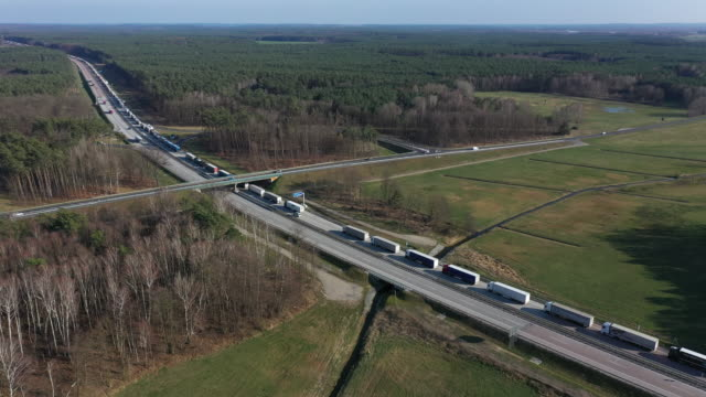 in this aerial view trucks on the a12 highway stand backed up approximately 70km before germany's border to poland on march 18 2020 near spreenhagen... - germany stock videos & royalty-free footage