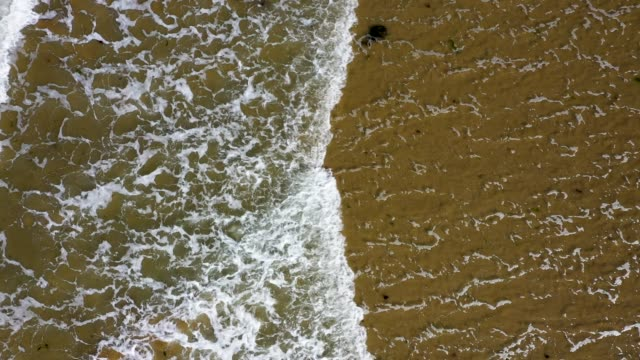 in this aerial view waves wash onto omaha beach in normandy on may 4 2019 at saintlaurentsurmer france june 6 will mark the 75th anniversary of the... - normandie stock-videos und b-roll-filmmaterial