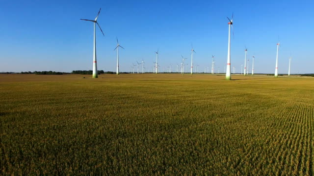 In this aerial view wind turbines spin at a wind farm on August 16 2018 near Altentreptow Germany Germany has been steadliy raising its share of...