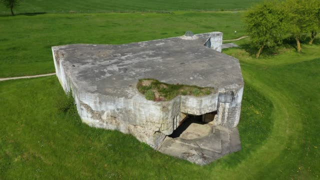 in this aerial view world war iiera german artillery bunkers that point towards the english channel stand in normandy on april 29 2019 at azeville... - d day stock-videos und b-roll-filmmaterial