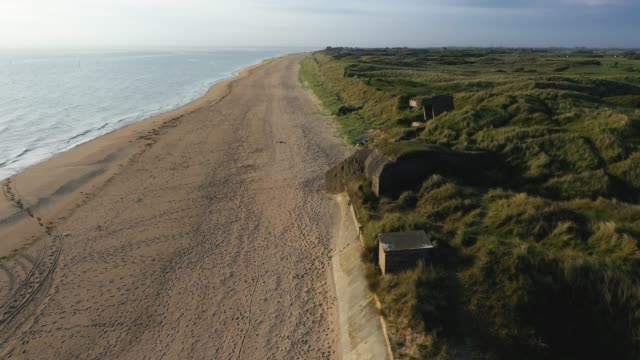in this aerial view world war ii-era german bunkers look out at utah beach in normandy on may 2, 2019 near sainte-marie-du-mont, france. june 6 will... - normandy stock videos & royalty-free footage
