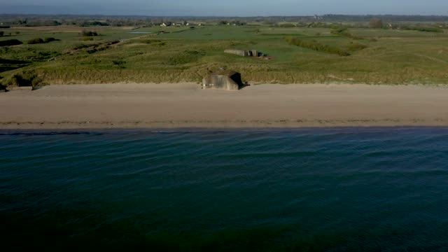 in this aerial view world war iiera german bunkers look out at utah beach in normandy on may 2 2019 near saintemariedumont france june 6 will mark... - normandie stock-videos und b-roll-filmmaterial