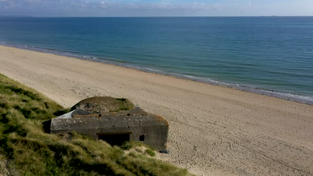 in this aerial view world war ii-era german bunkers look out at utah beach in normandy on may 2, 2019 near sainte-marie-du-mont, france. june 6 will... - d day stock videos & royalty-free footage