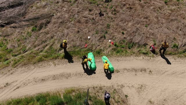 in this footage taken with a drone, volunteer firefighters practice with fire shelters during a wildfire training course on may 8, 2021 in brewster,... - dirt track stock videos & royalty-free footage