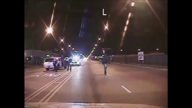 In this handout video clip provided by the Chicago Police Department MrMcDonald is seen jogging down the middle of a street He slows to a walk as he...