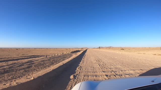 in this image captured on the driver's point of view, a car is driven along a road that crosses the desert next to swakopmund, namibia, on april 4,... - point of view stock videos & royalty-free footage