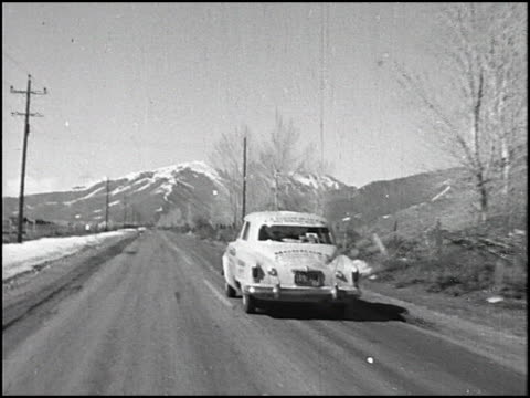 stockvideo's en b-roll-footage met / in this last of 5 segments the economy run cars stop in salt lake city at the end of the second day / studebaker cars continue to sun valley / when... - startvlag