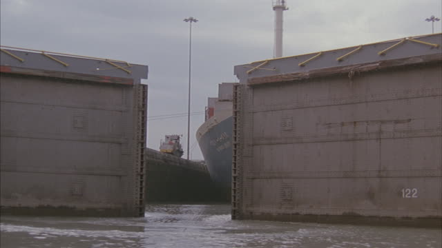 in this point-of-view shot, lock doors open for a ship to move into another panama lock. - panama canal stock videos & royalty-free footage