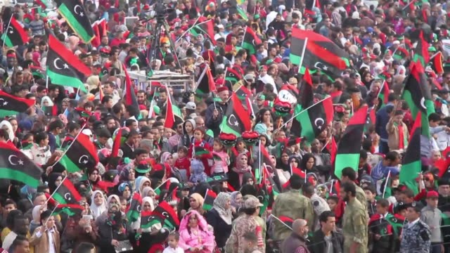 in tripolis martyrs square hundreds of libyans waved libyas flag as a crowd celebrated five years since the start of the revolution that toppled... - revolution stock videos & royalty-free footage
