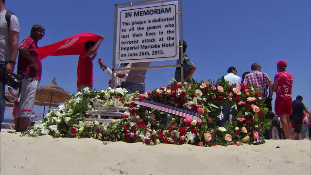in tunisia the only sound came from the lapping waves of the mediterranean as dozens of tourists and locals fell silent to remember those who lost... - jihad stock videos & royalty-free footage