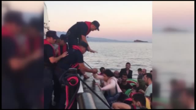 in turkey's aegean province of mugla the turkish coast guard held 37 people including women and children who were trying to cross to greek islands... - mugla province stock videos and b-roll footage