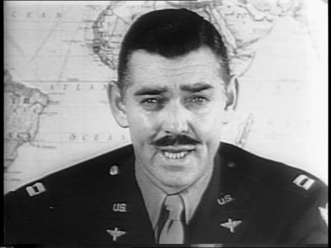 in uniform closeup of clark gable walking alongside troops / at desk in front of map captain gable speaks to camera regarding the war effort and the... - gable stock videos & royalty-free footage