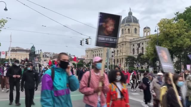 """in vienna, the capital of austria, illegitimate and racist practices against those displaced were protested on """"world refugee day"""". protesters... - banner stock videos & royalty-free footage"""