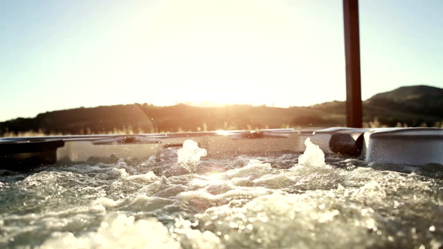 In whirlpool hot tub at sunset
