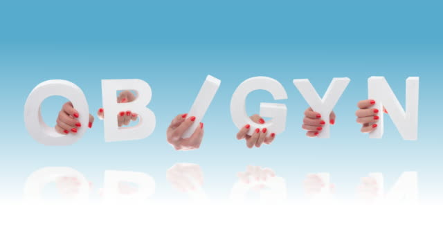 ob/gyn in white cardboard letters - obstetrician stock videos and b-roll footage