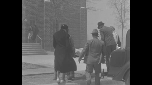in wind and dust several people lift person on stretcher out of car and take him towards hospital entrance / inside hospital nurses move about... - dust bowl stock videos and b-roll footage