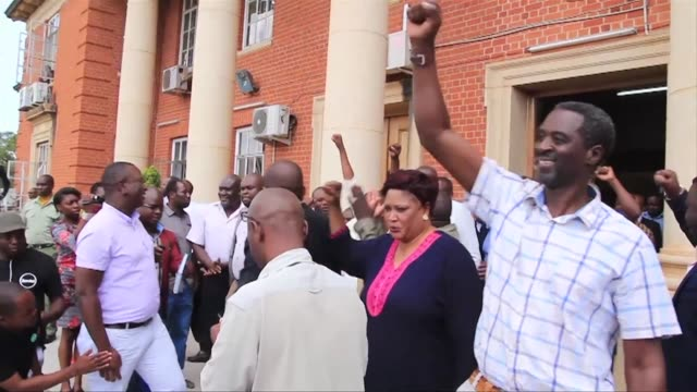 in zambia supporters of incumbent president edgar lungu celebrate as the constitutional court rules that he will be eligible to stand for reelection... - rules stock videos & royalty-free footage