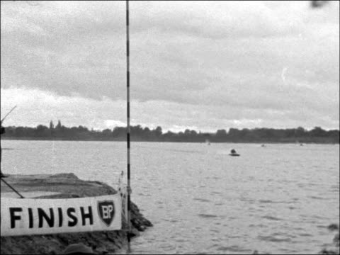 inaugural meeting of the london motor boat racing club england surrey shepperton ext wide shot cars parked with boats on trailers / various shots... - capsizing stock videos and b-roll footage