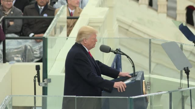 donald trump speech side shot from the north riser starts with him almost looking to the camera key soundbites america first america will start... - inauguration into office stock videos & royalty-free footage