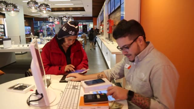Inc employees assist customers inside a store in New York US on Monday Jan 25 2016 Photographer Michael Nagle Bloomberg Shots Close up shots of...