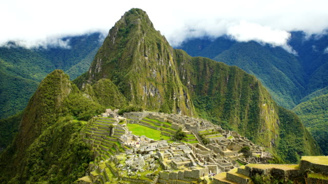 inca city ruins machu picchu rainforest south america - machu picchu stock videos & royalty-free footage