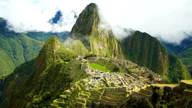 inca city ruins machu picchu sacred mountain peru - machu picchu stock videos and b-roll footage